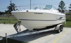2004 Cobia 215 Dual Console For those of you who have never considered a Dual console boat. Take a look at the advantages! This is a great family/fishing boat. It has the best of all worlds for both activities! Up front it has the optional bow cushion