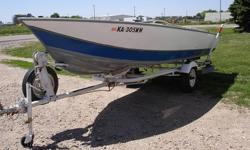 For Sale: A little 17 ft Aluminum Fishing Boat perfect for the right fisherman. This little baby has two seat that the upholstery is in great condition, with no rips or tears. The front of the boat has a lockable storage unit perfect to store your life