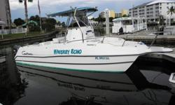 2000 Pro Sport Boats 2650 ProKat 28? Length 102? width No-Rot Full Fiberglass Hull Center Console Electronics box T-Top / Rocket Launchers Leaning Post Built-in tackle storage Head in small console cuddy Stainless Steering Wheel 2 Bait/Live Wells