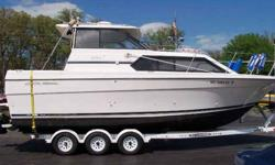 *** JUST REDUCED AND READY FOR THE WATER ***This boat was made for Michigan waterways! Many upgrades! Includes: Triple axle trailer, heat/air, microwave, refrigerator, shorepower, 7.4L MPI B2 310hp, bow thruster, camper enclosure, trim tabs, dual burner