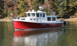 Tennessee Rover is a very well-maintained and customized 2007 34' American Tug (Hull #111). The sellers are her original owners and had her salon designed with room for two lounge chairs and a desk instead of built-in furniture during construction.