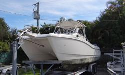 Powered By Twin Counter Rotating Yamaha 200 HPDI Outboard Motors, Hard Top, Garmin GPS, VHF, Dive Ladder, This Beauty Is In Excellent Condition. Also Includes A Trailer!.