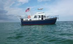 1979 T.D. Vinette steel hull, ocean going trawler. 37 on deck, 41 LOA, draft 4 ft. Located on fresh water, Great Lakes until 2012, then St. Johns River, Fl (fresh water). I sandblasted hull to bare metal when I bought it, applied 5 barrier coats of epoxy,
