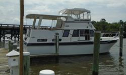This comfortable classic offers a roomy layout with 2 berths, 2 full heads, large salon and aft deck. The open space on this boat rivals that of some much larger yachts. Well maintained with the current owner still updating many parts. Draft: 3 ft. 6 in.