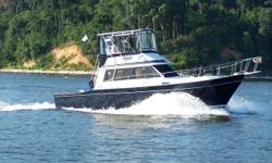 Great Catch is a classic 1985 38' Californian convertible. She offers twin Crusader 350 hp main engines, low-hour Onan generator, wide side decks, large cockpit, Eisenglass enclosed flybridge and a comfortable and functional galley layout. Her motivated