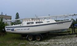 1976 26' Balboa sailboat, with full set of sails and tandem axle trailer. The auxiliary motor is a 1997 Mercury 9.9, electric start. The center board cable is frayed and should be replaced. Otherwise, the boat is sound and needs only some TLC. The