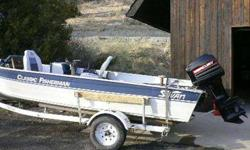 1994 Sylvan sixteen Fisherman Classic motor boat, with 40 HORSEPOWER Automatic start, Power Tilt. This is a side Console fishing boat with a fish finder, a twelve volt trolling engine, new Optima battery, new Custom Boat Cover. The engine has very low
