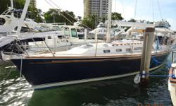 """Fidelio is a 2001 40' Sabre 402 in nice condition. She offers a 55 hp Yanmar auxiliary with only 1,630 hours, 3.8 kW generator with only 395 hours, 5'3"""" draft, in-boom furling main and a clean, uncluttered interior. Her sellers are moving to a"""