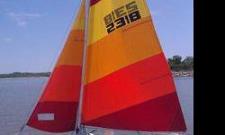 """Sea Spray fifteen catamaran LOA 15' Width 66"""" Mast height 20' 2"""" standard halyard rig sails are in VG condition bright red, org, yellowweighs less then 200 pounds comes with boat trailer & registrationCurrently stored on Tuttle creek Blue Valley Yacht"""