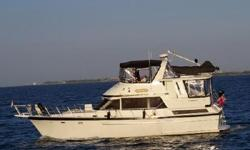 Ithaka is a very well-maintained 42' Jefferson offering a full beam master stateroom aft, guest stateroom forward with ensuite head, updated electronics, new bottom paint and zincs in 2015, newer Caterpillar main engines, new aluminum fuel tanks in 2008
