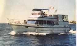 Our Wisha 3 is a 1986 42' Oceana sundeck motoryacht offering a 2 stateroom, 2 head, galley down layout and fuel-efficient Ford Lehman 135 hp main engines. She has served as a liveaboard in the Florida Keys for the past few years. Her owner has moved