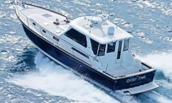 Quiet Time is a 2004 42' Sabre Hardtop Express.  She offers twin Yanmar 500 hp main engines, Westerbeke 12.6 kW generator, Sidepower bowthruster, Reverso oil change system, Vacuflush head, Garmin electronics, 2 stateroom layout and a clean,