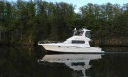 Phoenix is a 2001 42' Silverton in very nice condition. She offers twin Cummins 370 hp main engines, Kohler 8 kW generator, bowthruster, molded-in steps from the cockpit to the flybridge, a very popular interior layout and a satellite TV