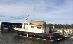 This meticulously maintained single owner Bruce Roberts designed trawler is ready to take you cruising. Stepping into the salon you will find comfortable seating for 6 with a couch, chair and breakfast counter with 2 stools. A full size oven and range