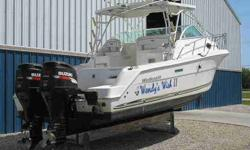 2001 Wellcraft 290 COASTAL Indoor stored 290 Coastal Walk-Around with plenty of options including Twin 2005 Suzuki DF250 FOUR STROKE Outboards (Low hours), AC/Heating, Generator System, Full Galley & Head, Garmin GPS, Auto Pilot,VHF Radio, Out-Riggers and