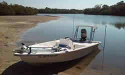 97 16Ft flats boat (bay skiff) 2 stroke 60 hp mariner starts up every time no issues. Brand new 55 bow mount prowler troling motor. 6 ft stick it pole live well front bow large storage hatch brand new aluminum trailor by rocket international in ft myers