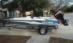 2004 Nitro 640 LX Tracker 16 4 Bass Boat with upgrade 90 horsepower outboard engine. Comes with boat cover, trailer, (2) props- 4 blade stainless steel and factory propeller, 12 volt trolling engine, onboard charger, extra seat, two depth finders - 1 is
