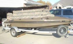 2002 Duck Wrangler 15'. 40 Hp Mercury Motor. 2 Blinds: one short, one tall. Galvanized Yacht Club. 58Lb Trolling Motor. 2 batteries & fuel tanks.Any questions or if you would like to see this boat contact Denny at. email dkozol@cox.net.Listing originally