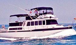 Ten Knots offers any family plenty of live-aboard storage space and large comfortable seating, private staterooms with ensuite heads and stall showers, huge flybridge and aft deck seating, twin helm stations, reliable Caterpillar diesels burning eight