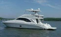 PRICE JUST REDUCED $100,000 Three stateroom interior with cherry cabinetry features elevated galley and dinette along with facing salon settees. Extravagant full-beam master stateroom. Huge flybridge features hardtop, ac, refrigerator and twin thigh-rise