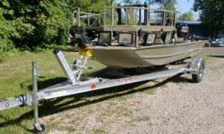 This boat only has about 2 hours on it. It is powered by a Mercury 90hp 4 stroke outboard. Some of the features are: removable elevated bow shooting deck w/railing, rail mounted drink and arrow holders, 3 pedestal bases and trolling motor access hatch,