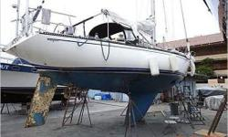 General Description Designed by Sparkman & Stephens, Macavity was a very well-outfitted Catalina 38. She is one of the last Catalina 38s built by the factory. The keel-stepped mast abuts the bulkhead forward of the main salon. Forward of the bulkhead are