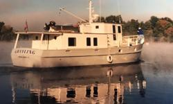 Grayling is a 47 ft steel raised pilot house trawler. She was designed as a honest cruising boat to be operated by a couple under almost any condition. She is fully live aboard and equally able at sea or at anchor. Her short mast is on a tabernacle and