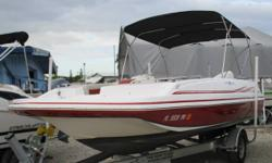 Powered With A Evinrude E-Tec HO E135DHX. This boat is ready for the water! The engine is clean as a whistle and has perfect compression. All of the pumps, lights, switches and accessories are in working order. There is ample seating and storage as well