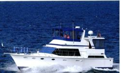 "This new to the market 47 Marine Trader ""IDGARA"" is turn key and ready to cruise through the Great Lakes or the Bahamas. Cruise with the confidence of twin Cummins engines and an electronics package at both helm stations. IDGARA's owners fitted her out"