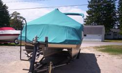 BEAUTIFUL CONDITION ONE OWNER SUNBRELLA COVER TANDOM AXLE TRAILER Beam: 8 ft. 5 in. Hull color: TEAL Optional features: FREE STANDING COOLER TABLE TRIM PACKAGE LOUNGER ARM W/TRASH STORAGE SUNDECK W/REAR GATE DUAL BATTERY SWITCH BOW ANCHOR LOCKER IMCO FUEL