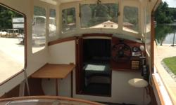 2002 Tautog. One-of-a-kind hand-made wooden boat. This boat was built over the course of 3 years by a close family friend who was a master boat builder and restorer. It was based on plans that he found from the 1930s and is believed to be the only one