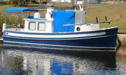 A Classic Beauty 1984 26 NORDIC TUG with 2012 Custom Trailer 100 HP Yanmar Single Inboard Diesel 4 KW HTL GENERATOR Garmin 4212 Chart Plotter and Radar Trac vision Satellite. Cruises at 8 knots and only draw 3 feet for fabulous gunkholing in the Florida