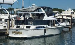 OPTIONS is a Very Clean 44 CPMY with upgrades thru out that include Electronics, both Motor's serviced, Exhausts components serviced, New Canvas and Hull buffed and waxed. Excellent layout with V-berth forward with en suite head, Galley is down with good