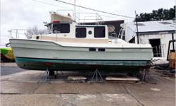 Actual Condition It is reported this 31' Ranger was on land during heavy rains and the drain plug was not removed. Fresh water entered and was just under the cabin floors. The hull was drained and washed down. The seats in the cabin show signs of wear on