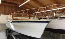 This is a Factory Refurbished 26' Runabout which has had a complete and extensive restoration at Skiff Craft by the people who built her. The bottom was replaced, the original flybridge was removed and the boat became a runabout with an all new mahogany