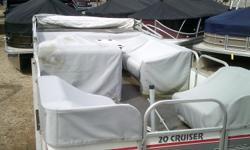Cruising pontoon with individual seat covers and a bimini top. Powered by a 2015 Mercury 25hp four stroke EFI. No trailer. Beam: 8 ft. 0 in. Hull color: White/Grey Stock number: Zitske Boat cover; Bimini top;