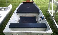 14 foot Jon boat with added on floor and front deck. Hand remote anchor and 2 oars included.