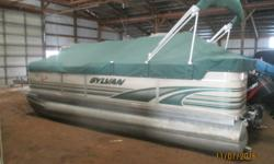 A real nice cruising pontoon in great shape. Powered by a Mercury 50 hp 2 stroke motor. Comes with bimini top and full cover. Buy now and we will deliver in spring. Beam: 8 ft. 0 in. Fuel tank capacity: 6 Hull color: Green Stock number: Fries