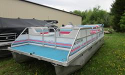 Festive colors on this older, but nice pontoon. Powered by a Johnson 40hp 2 stroke motor. Beam: 8 ft. 0 in. Hull color: Blue/Pink Stock number: Buchaklian