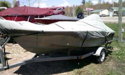 A wide fishing boat. Has 4 seats, 2 spare tires, locator, trolling motor and cover. Just in time for fishing season. Add your own motor but does come with a trailer. Beam: 6 ft. 6 in. Fuel tank capacity: 6 Hull color: Grey Stock number: Grassy Boat cover;